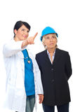Doctor showing to architect woman Royalty Free Stock Images