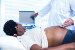 Doctor showing ultrasound results to pregnant woman Royalty Free Stock Photography