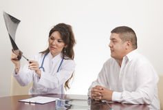 Doctor is showing x ray Royalty Free Stock Images