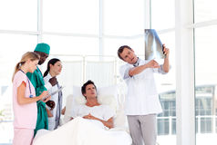 Doctor showing an X-ray to his patient Royalty Free Stock Photo