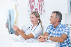 Doctor showing X rays to her patient Stock Photo