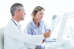 Doctor showing xray to his patient Royalty Free Stock Image