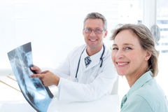 Doctor showing xray to his patient Royalty Free Stock Images
