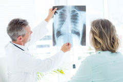 Doctor showing xray to his patient Royalty Free Stock Photo