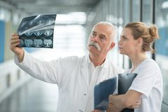 Doctor showing xray to senior patient in hospital Stock Photo