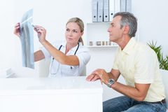 Doctor showing Xrays to her patient Royalty Free Stock Photo