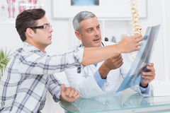 Doctor showing Xrays to his patient Stock Photo