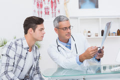 Doctor showing Xrays to his patient Stock Image