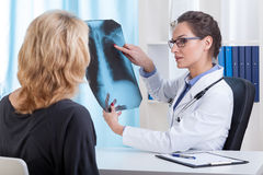 Doctor shows chest x-ray Royalty Free Stock Photo