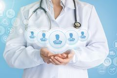 Doctor shows in the hands of a team of doctors . royalty free stock photography