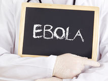 Doctor shows information: Ebola. Doctor shows information on blackboard: Ebola stock image