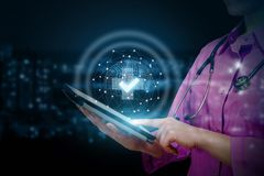 Doctor shows on mobile the quality of medical services royalty free stock image