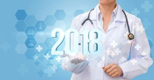 Doctor shows the numbers 2018 . Banner the new year Royalty Free Stock Image
