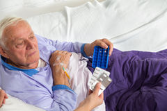 Doctor shows the patient how to use daily dose pills Stock Photos