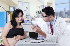 Doctor shows result test on digital tablet Royalty Free Stock Photography