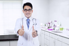 Doctor shows thumbs up in the clinic Stock Image