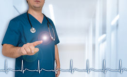 Doctor shows on viewer with heart rate template concept Stock Photos