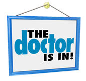 The Doctor is In Sign Check-Up Physical Appointment Office Adver. The Doctor Is In words on a hanging office window sign to advertise the physician or medical Royalty Free Stock Photos