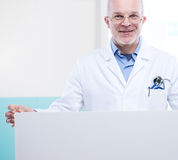 Doctor with sign Stock Images