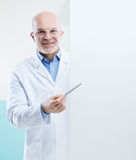 Doctor with sign Royalty Free Stock Photos
