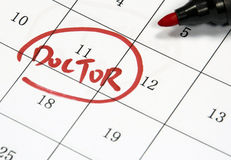 Doctor sign written with pen on paper Stock Images