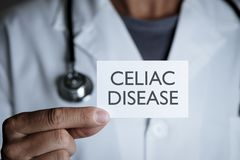 Doctor and signboard with text celiac disease stock photos