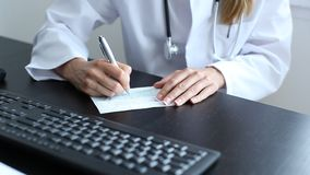 Doctor signs a prescription Royalty Free Stock Photos