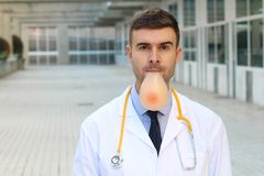 Doctor with silicon implant in his mouth stock images
