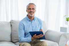 Doctor sitting with a clipboard stock images