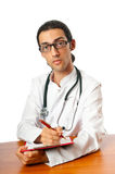 Doctor sitting at the desk Royalty Free Stock Photo