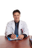 Doctor sitting at desk stock photo
