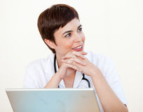 Doctor sitting at desk in Hospital Stock Photos