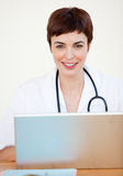 Doctor sitting at desk in Hospital Royalty Free Stock Image