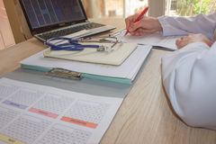 Doctor sitting at the desk near window. Medicine doctor`s workin Stock Images