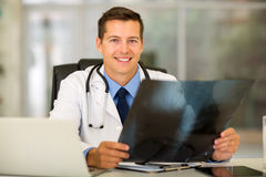 Doctor sitting office Stock Photos