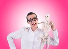 Doctor with skeleton against gradient Stock Photo