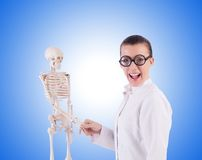 Doctor with skeleton on the white Stock Photos