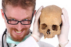 Doctor with skull Stock Photos