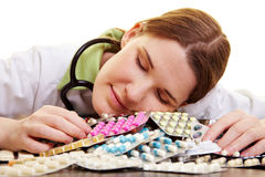 Doctor sleeping on heap of pills Royalty Free Stock Photos