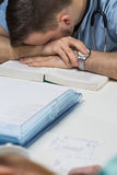Doctor sleeping on the table. Overworked male doctor sleeping on the table Stock Image