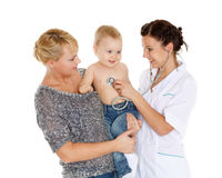Doctor and small patien. Pediatrics. Stock Photos