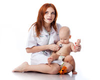 Doctor and small patient Royalty Free Stock Image