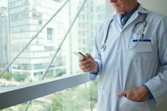 Doctor with smartphone Stock Photos