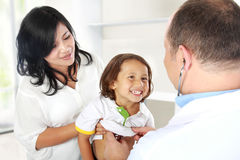 Doctor with smile kid Stock Image