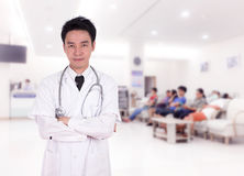 Doctor smiling with arms crossed Stock Photo
