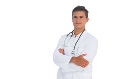 Doctor smiling with arms crossed Royalty Free Stock Images