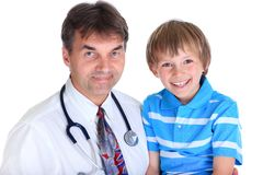 Doctor with smiling boy Stock Photos