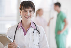 Doctor Smiling at Camera Stock Photo
