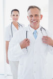 Doctor smiling at the camera Stock Photography