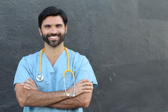 Doctor smiling with his arms crossed with copy space royalty free stock image